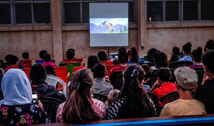 Mobile cinema brings smile on Syrian Kurd children's face