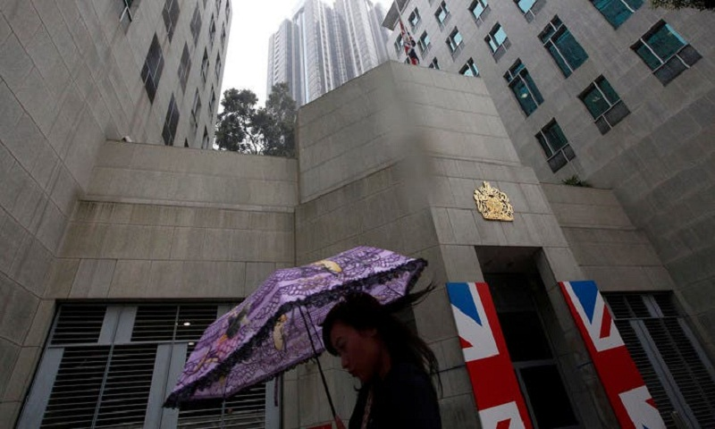 China says British consulate staffer detained 15 days
