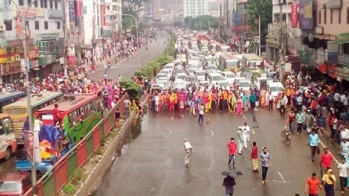 Alif Apparels' RMG workers go on protest, block road