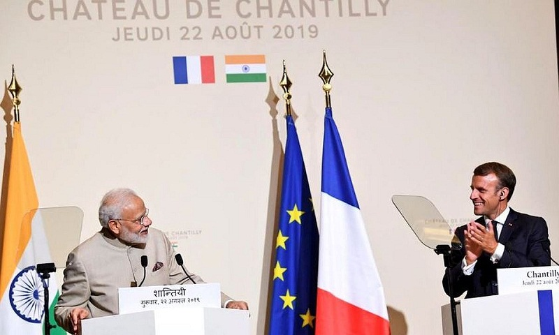 Indian PM Modi in France on first leg of 3-nation trip; Macron against 'third party' interference in Kashmir