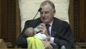 New Zealand parliament speaker soothes MP's baby as debate rages