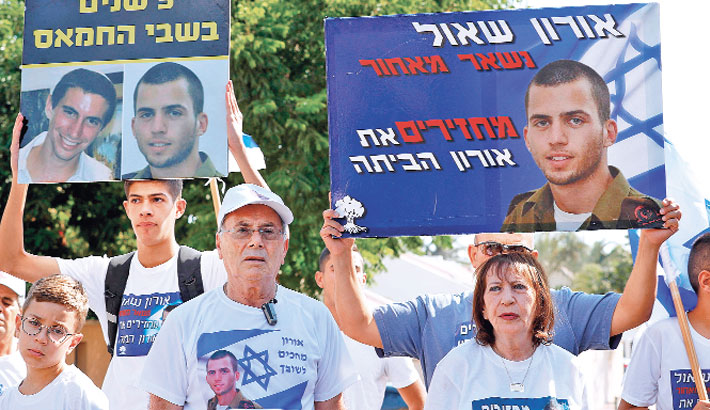 Friends and relatives of slain Israeli soldier Oron Shaul