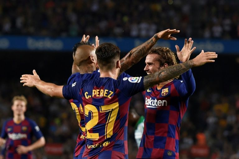 Griezmann scores twice as Barcelona put five past Real Betis