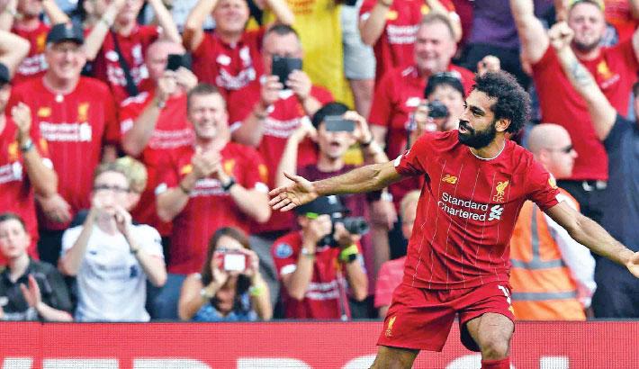 Salah shines as Liverpool sink Arsenal