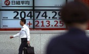 Asian shares mostly up on optimism about US-China trade war