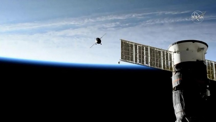 Soyuz spacecraft carrying Russian humanoid robot docks at ISS after failed attempt