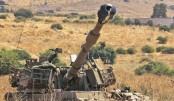 An Israeli self-propelled artillery gun is positioned near the Lebanese border