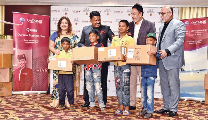 Qatar Airways gives 500 toy boxes to school children