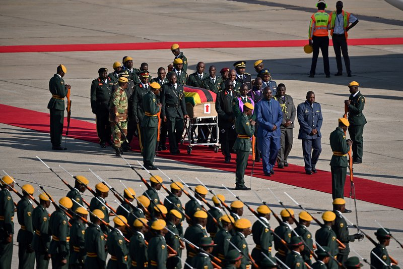 Mugabe's body arrives home for burial in divided Zimbabwe