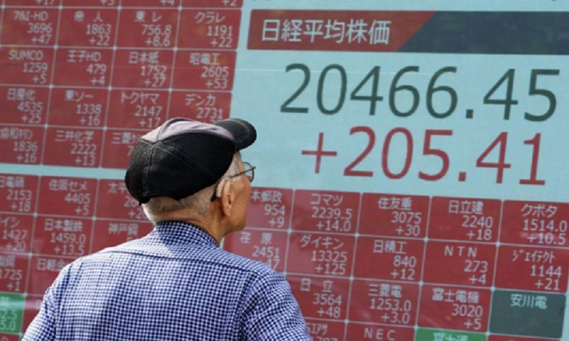 Asian markets boosted by fresh trade hopes and ECB easing