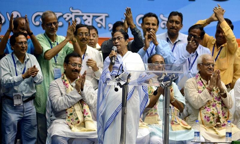 Mamata runs into Indian PM Modi's wife at Kolkata airport before leaving to meet him