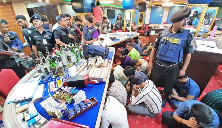 142 arrested in casino raid
