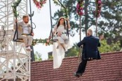 Love is in the air! German aerial artist ties knot hanging on high-wire