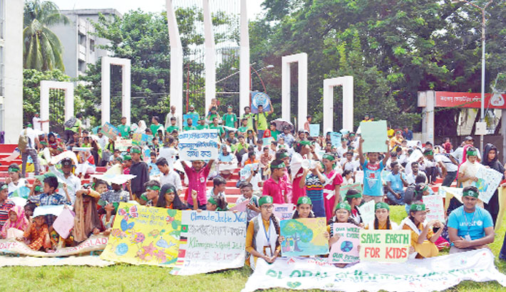 Schoolchildren and members of climate-related organisations take part in a sit-in programme