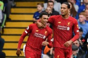 Liverpool down Chelsea to extend perfect start