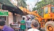 Illegal structures on footpath demolished