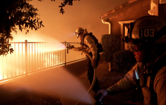 Wildfire rages on LA's northern edge, thousands evacuated
