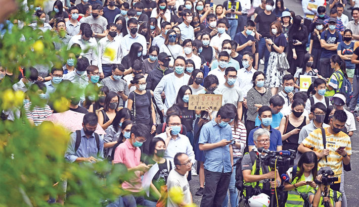 Hundreds take to HK streets, weekend protests planned