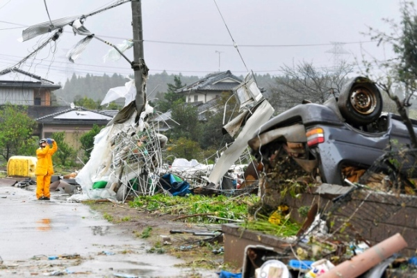 Death toll rises to 20 as Typhoon Hagibis lashes Japan