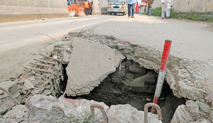 Concrete slab of the footpath lies badly damaged