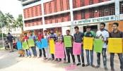 Students of Rajshahi University form a human chain