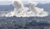 Turkish, Kurdish forces battle for key Syrian border town