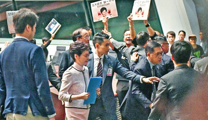 Chaos as HK MPs thwart leader's annual address