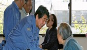 Japan PM visits storm-hit areas, royal parade may be delayed
