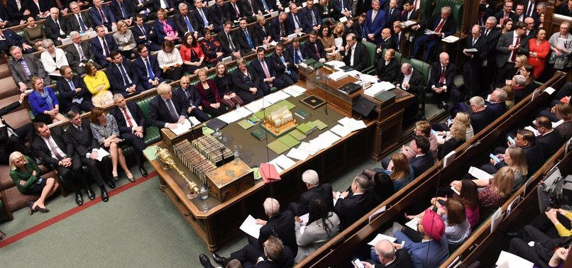 UK lawmakers vote to delay final Brexit decision again