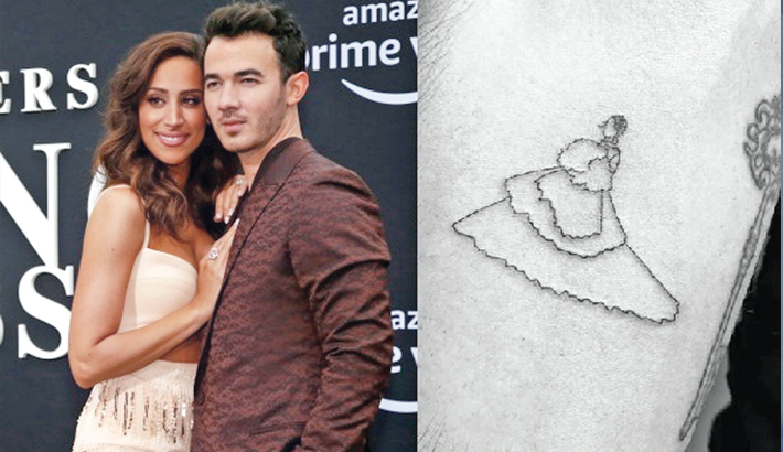 Kevin debuts 'Sucker' tattoo dedicated to wife
