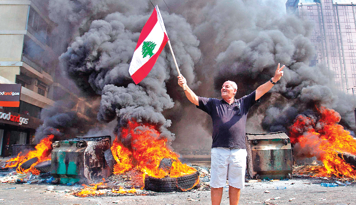Thousands of Lebanese demonstrate against taxes, corruption