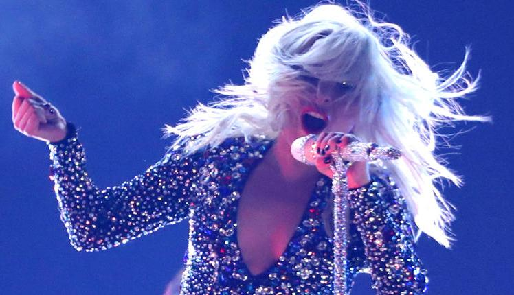 Lady Gaga falls off stage while dancing with fan (Video)