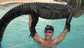 Man swims with alligator to tire it out, catches it with bare hands