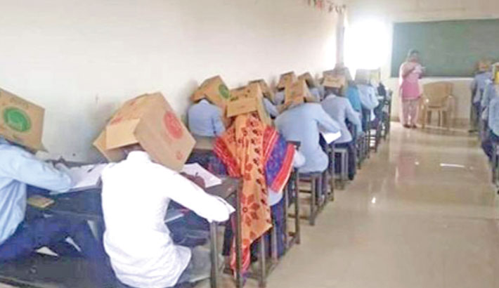 Students wear cardboard boxes in exams