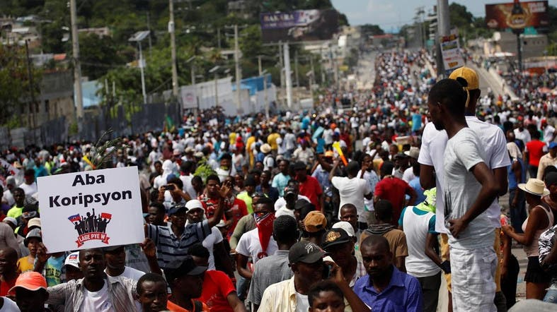 Thousands protest against Haiti's president