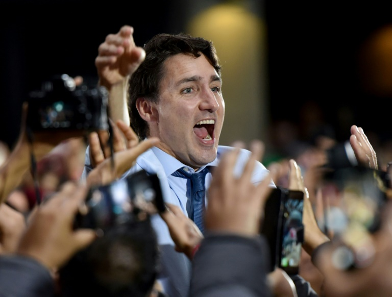 Canada vote too close to call as Trudeau hopes to cling on