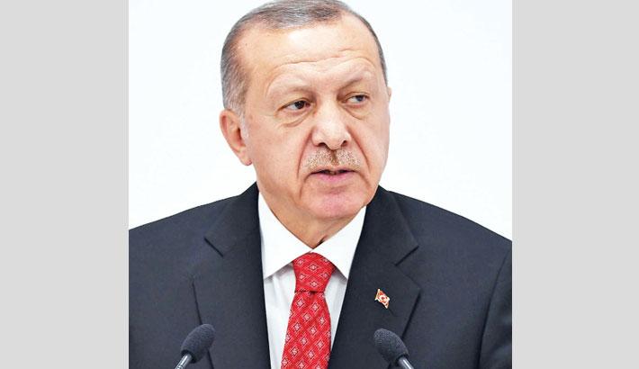 Erdogan threatens to restart Syria offensive
