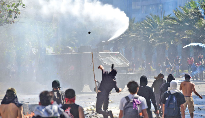Chile orders new curfew as violent protests rage