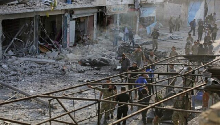 At least 13 dead in car bomb in Syrian border town