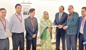 PM hands over cheque for donation