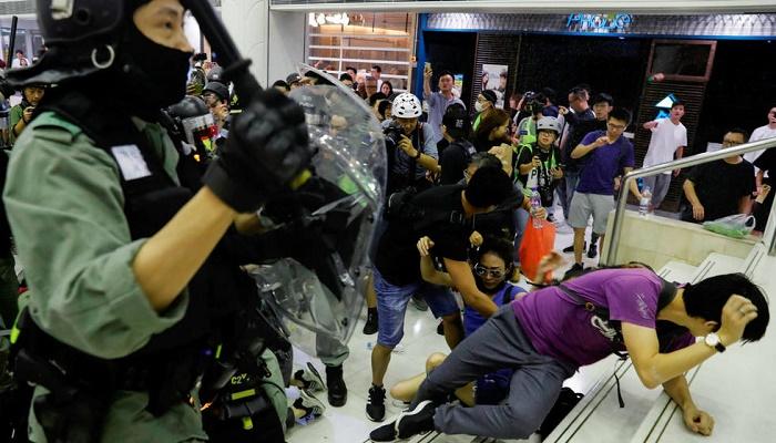 Protesters in Hong Kong vandalise subway station, storm mall