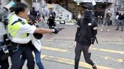 Hong Kong police shoot man in Monday morning rush hour protests