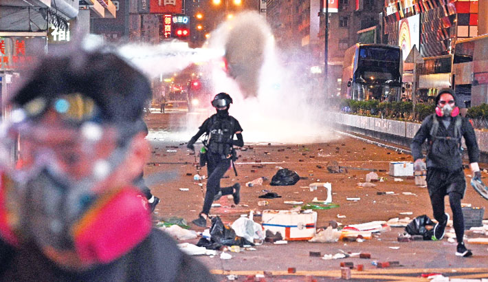 Police shoot protester, man set alight in a day of HK fury