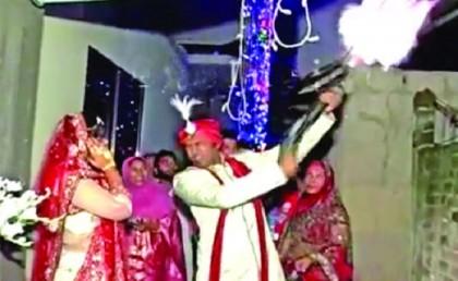 North Swechchhasebak League general secretary Anis fires blank shots at his wedding ceremony (Video)