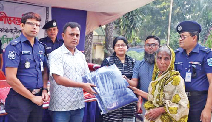 Distributes winter clothes among the poor