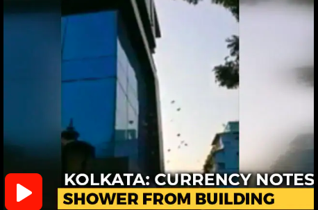 Shower of currency notes from building in Kolkata (Watch)
