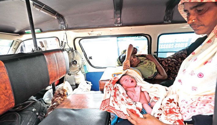 A newborn baby suffer immensely due to road block