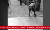 Bundles of cash rain down on street (Video)