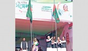 PM Sheikh Hasina is hoisting the national flag at the triennial council