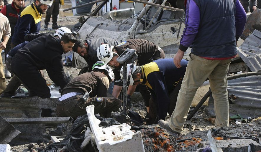 Airstrike on market in Syrian rebel-held town kills 10
